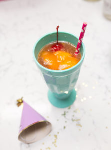 mango sorbet lemon cherry fizz malibu rum summer cocktail with pretty paper straw cherry man cherries