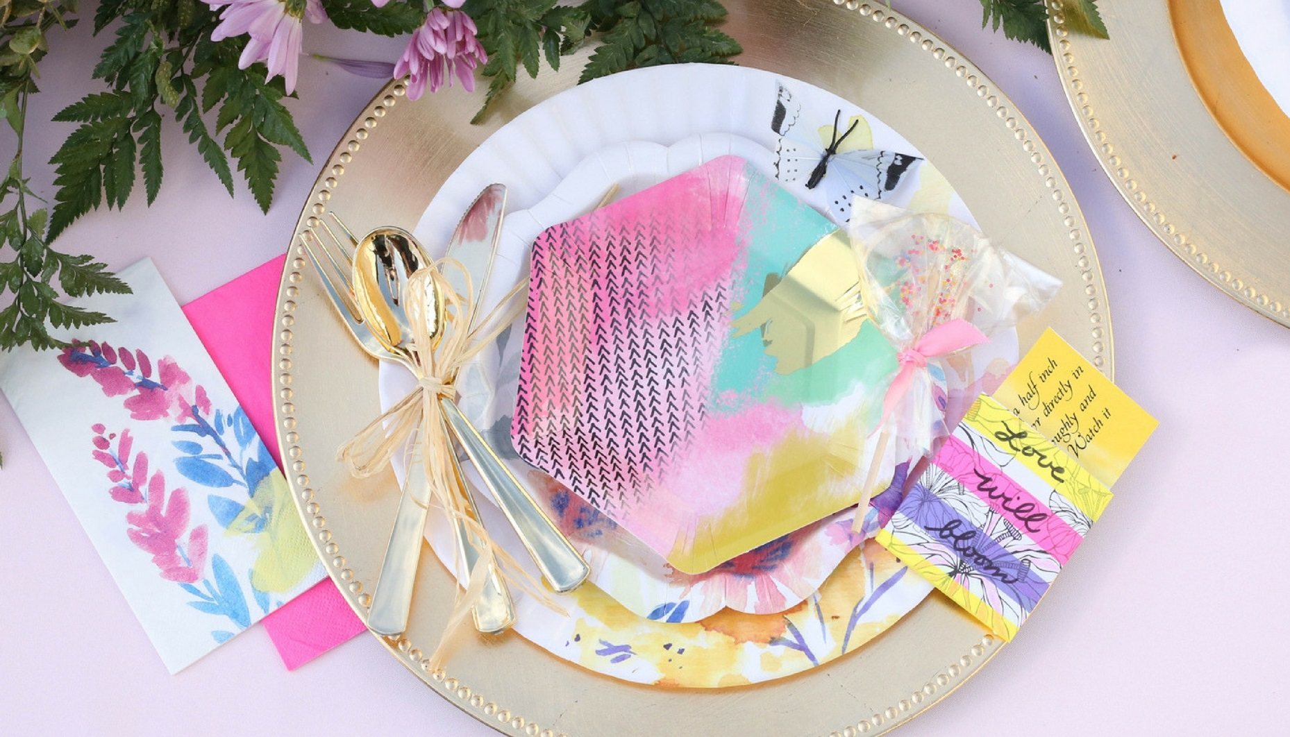 I love how the patterns vary from plate to plate. The bold neon napkins have such fun sayings on them! & Bright and Inspired Floral Wedding - Ritzy Parties