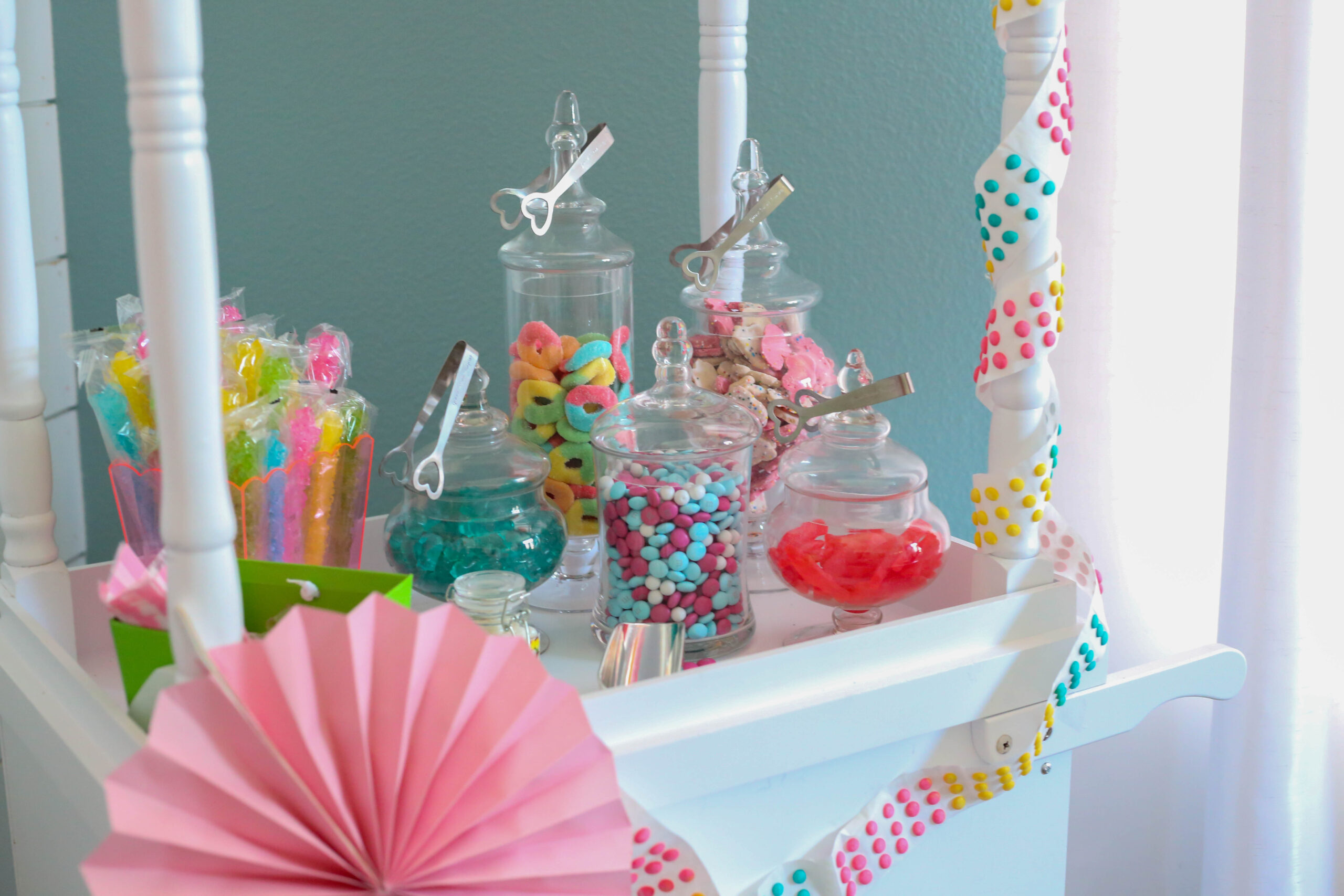 candy cart with candy jars filled with colorful candy