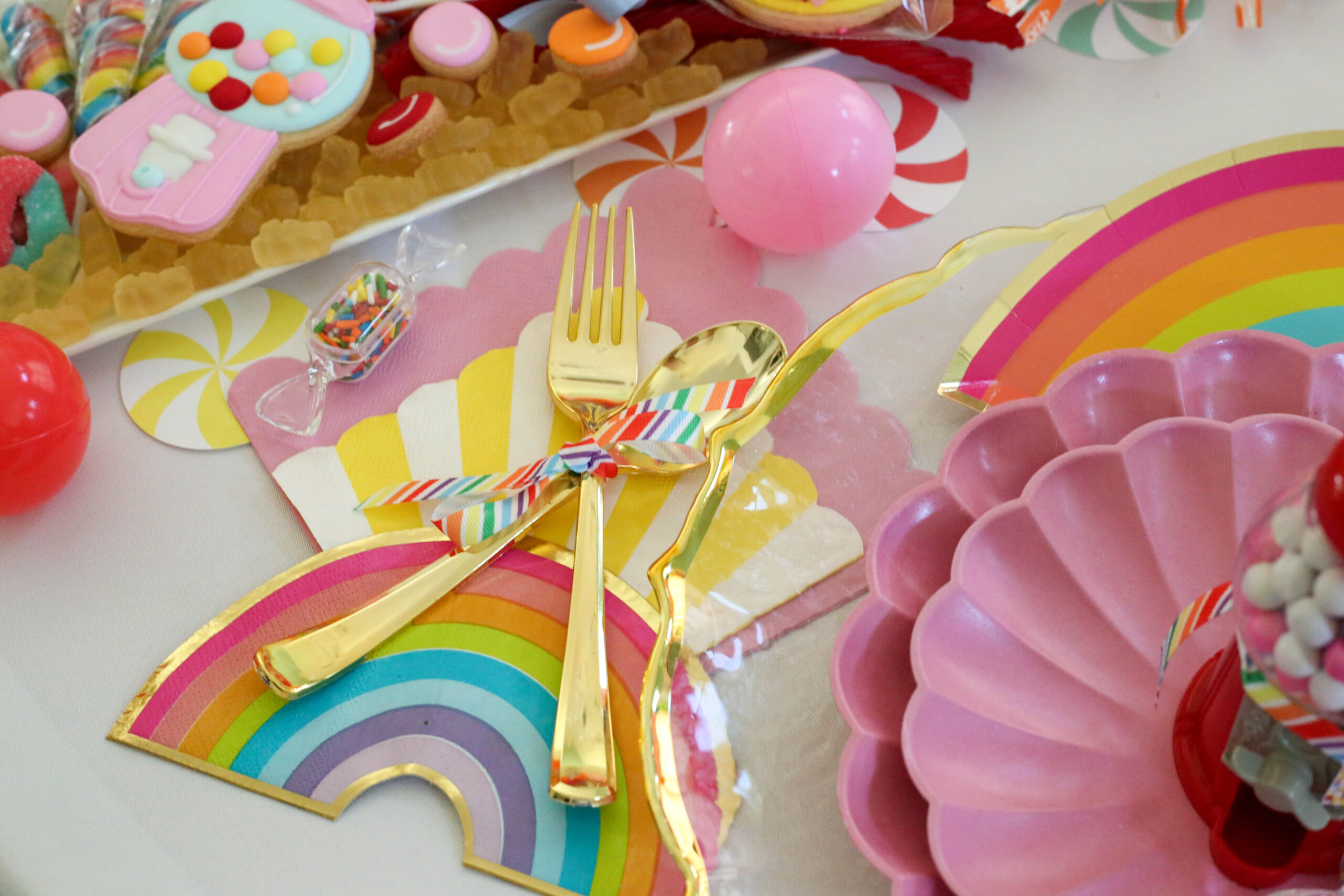 disposable gold flatware tied with ribbon grosgrain rainbow